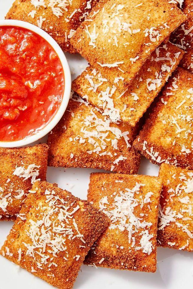 """<p>We are obsessed with ravioli, but most of the time we admit that the four pieces you get as a serving is not filling enough. That's why it makes the perfect app. Breaded and fried, it is so fun to eat ravioli with your hands and dipping it in plenty of marinara. Bonus! Toasted ravioli works in the air fryer too, meaning you can skip all of the oil for an even more perfect appetiser. </p><p>Get the <a href=""""https://www.delish.com/uk/cooking/recipes/a33212683/toasted-ravioli-recipe/"""" rel=""""nofollow noopener"""" target=""""_blank"""" data-ylk=""""slk:Toasted Ravioli"""" class=""""link rapid-noclick-resp"""">Toasted Ravioli</a> recipe.</p>"""