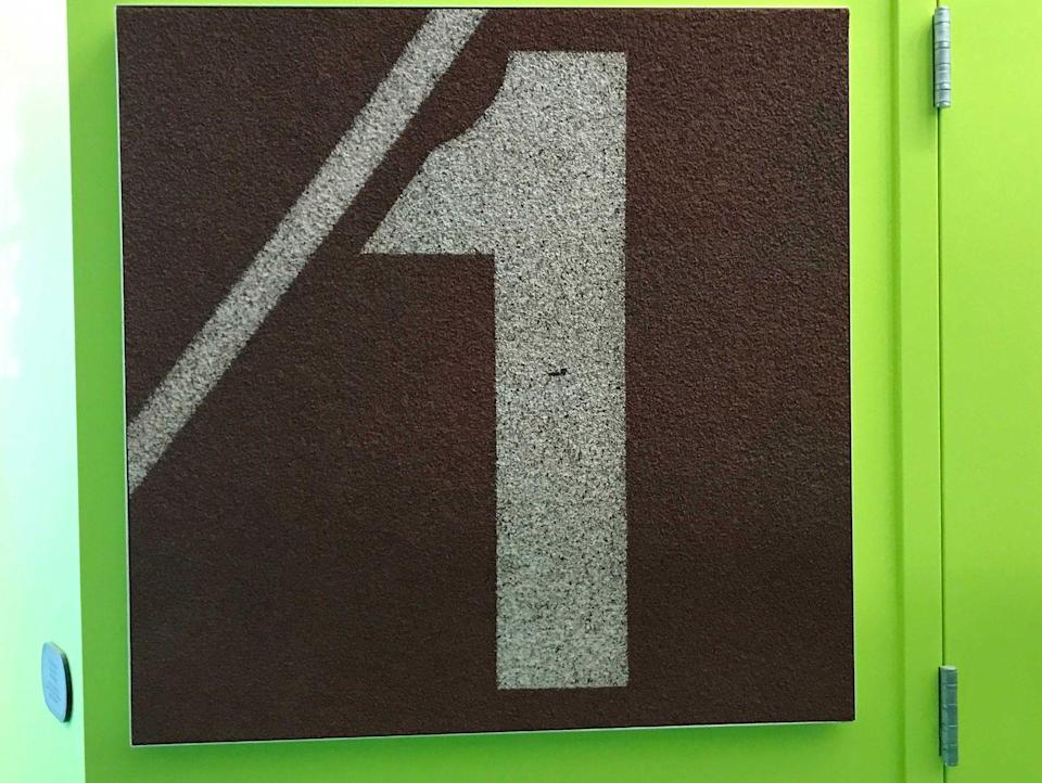 "<p>A piece of the previous Hayward Field track is mounted on the wall inside the stadium. Athletes can touch it for good luck on their way out to compete. </p><p><a href=""https://www.runnersworld.com/races-places/a32732854/track-and-field-olympic-trials-postponement-impact-on-eugene-oregon-hayward-field/"" rel=""nofollow noopener"" target=""_blank"" data-ylk=""slk:[Eugene, Oregon Was Nearly Ready to Host the Track and Field Olympic Trials. Then Coronavirus Hit"" class=""link rapid-noclick-resp"">[Eugene, Oregon Was Nearly Ready to Host the Track and Field Olympic Trials. Then Coronavirus Hit</a>]</p>"