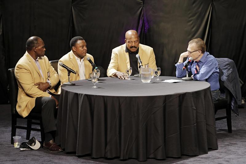 From left: Hall of Famers Harry Carson, Barry Sanders and Jim Brown talk about the road to Canton with moderator Larry King, right, at the inaugural Pro Football Hall of Fame Fan Fest Saturday, May 3, 2014, at the International Exposition Center in Cleveland