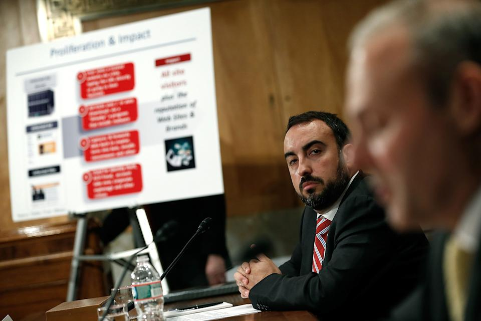 WASHINGTON, DC - MAY 15:  Alex Stamos, chief information security officer at Yahoo! Inc. (L) listens as Craig Spiezle (R), executive director, founder and president of the Online Trust Alliance testifies before the Senate Homeland Security Committee May 15, 2014 in Washington, DC. The committee heard testimony on the topic of on 'Online Advertising and Hidden Hazards to Consumer Security and Data Privacy.'  (Photo by Win McNamee/Getty Images)