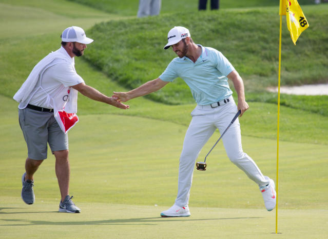 Matthew Wolff, right, celebrates with his caddie after putting for eagle on the 18th hole to win during the final round of the 3M Open golf tournament Sunday, July 7, 2019, in Blaine, Minn. (AP Photo/Andy Clayton- King)