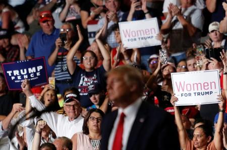 Members of the audience look on as U.S. President Donald Trump delivers remarks at a Keep America Great rally at the Santa Ana Star Center in Rio Rancho, New Mexico