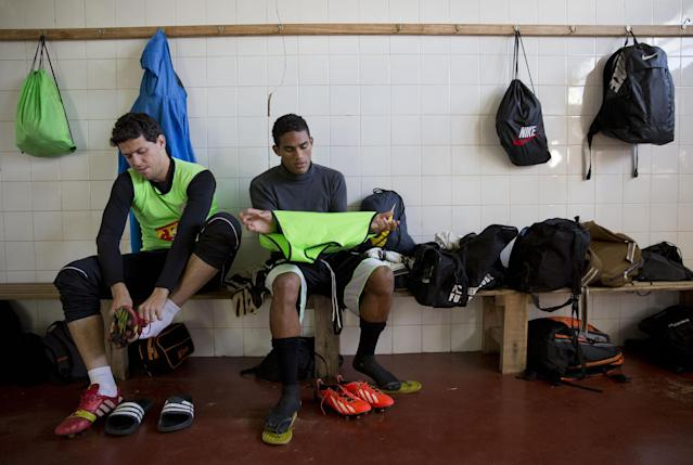 In this May 28, 2014 photo, players with the Presidente Prudente soccer club prepare to train in Presidente Prudente, Brazil. Presidente Prudente plays in front of only a few hundred fans in most of its matches at the city's stadium. (AP Photo/Andre Penner)