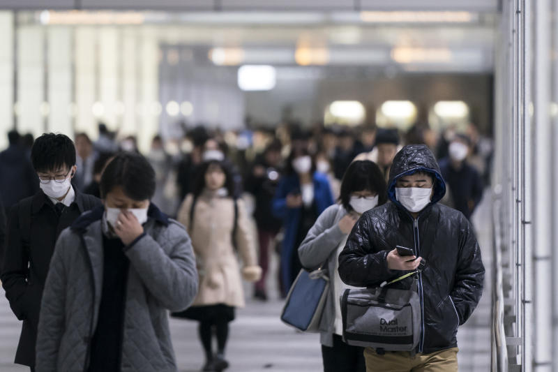 TOKYO, JAPAN - FEBRUARY 13: Pedestrians wearing face masks walk through an underground passage on February 13, 2020 in Tokyo, Japan. At least 219 passengers and crew onboard the Diamond Princess cruise ship have tested positive for COVID-19 making it the biggest centre of the virus outside China. Japan has also so far diagnosed 28 other people with the illness, some of whom are evacuees from Wuhan, and has announced measures to ban entry to foreign travelers from Zhejiang alongside an existing ban on non-Japanese nationals coming from Hubei. (Photo by Tomohiro Ohsumi/Getty Images)