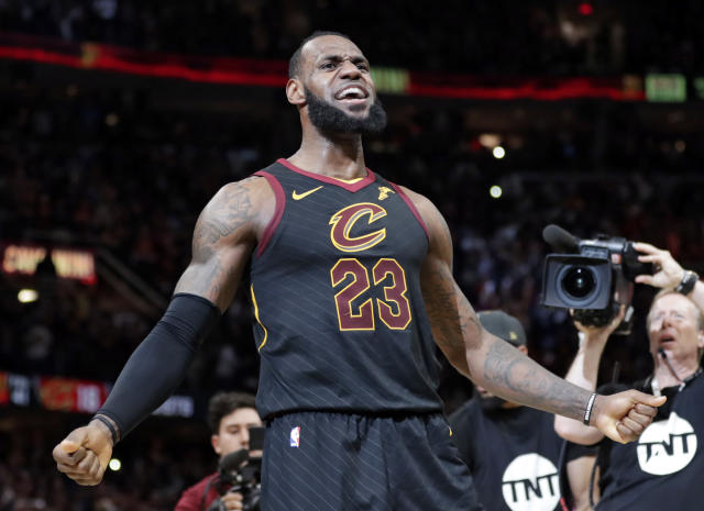 Cleveland Cavaliers' LeBron James reacts after making the game-winning shot in the second half of Game 5 of an NBA basketball first-round playoff series against the Indiana Pacers, Wednesday, April 25, 2018, in Cleveland. The Cavaliers won 98-95. (AP Photo/Tony Dejak)