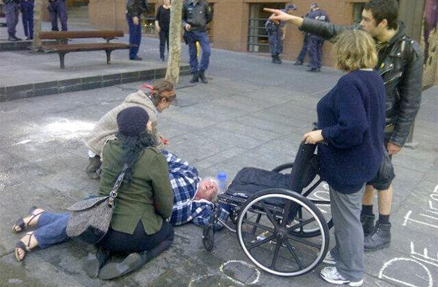 Woman falls from her wheelchair at the Occupy Sydney protest camp. An ambulance is called for her. Photo: @robertovadia