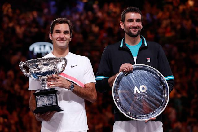 Tennis - Australian Open - Men's singles final - Rod Laver Arena, Melbourne, Australia, January 28, 2018. Switzerland's Roger Federer and Croatia's Marin Cilic pose with their respective winner and runner up trophies after Federer won the final.