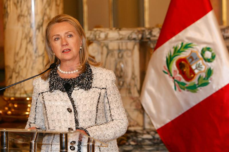 """U.S. Secretary of State Hillary Rodham Clinton delivers a speech next to a Peruvian flag after a meeting with Peru's President Ollanta Humala in Lima, Peru, Monday, Oct. 15, 2012. Clinton is in Peru to attend the International Conference: """"Power: Women as Drivers of Growth and Social Inclusion"""" on Oct. 16. (AP Photo/Karel Navarro)"""