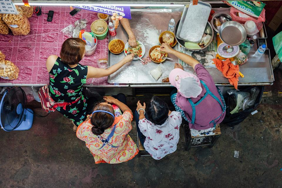 Chiang Mai, Thailand – Asians spend most of their extra income on food.