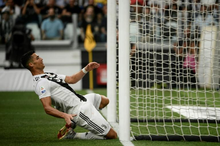 Cristiano Ronaldo slips towards the goal after missing a chance to score hist first goal for Juventus against Lazio