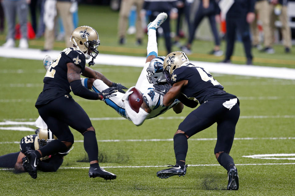 Carolina Panthers wide receiver Robby Anderson is upended by New Orleans Saints safety Chauncey Gardner-Johnson, left, and free safety Marcus Williams in the first half of an NFL football game in New Orleans, Sunday, Oct. 25, 2020. (AP Photo/Butch Dill)