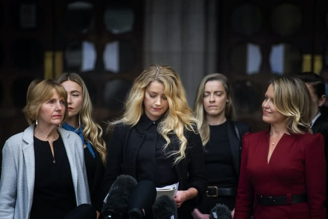 Actress Amber Heard, alongside her sister Whitney Henriquez (second right) and lawyer Jen Robinson (right), as she gives a statement outside the High Court in London on the final day of hearings in Johnny Depp's libel case against the publishers of The Sun and its executive editor, Dan Wootton. After almost three weeks, the biggest English libel trial of the 21st century is drawing to a close, as Mr Depp's lawyers are making closing submissions to Mr Justice Nicol