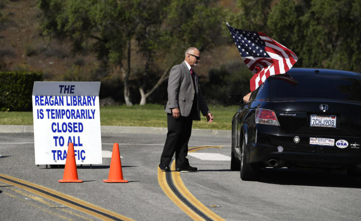 <p>Security guard Doug Wiley tells a prospective visitor on Sunday, March 6, 2016, that the Ronald Reagan Presidential Library is closed. <i>(Photo: Mark J. Terrill/AP)</i></p>