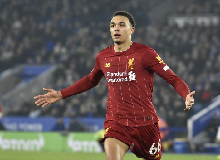 Liverpool's Trent Alexander-Arnold celebrates after scoring his side's fourth goal during the English Premier League soccer match between Leicester City and Liverpool at the King Power Stadium in Leicester, England, Thursday, Dec. 26, 2019. (AP Photo/Rui Vieira)