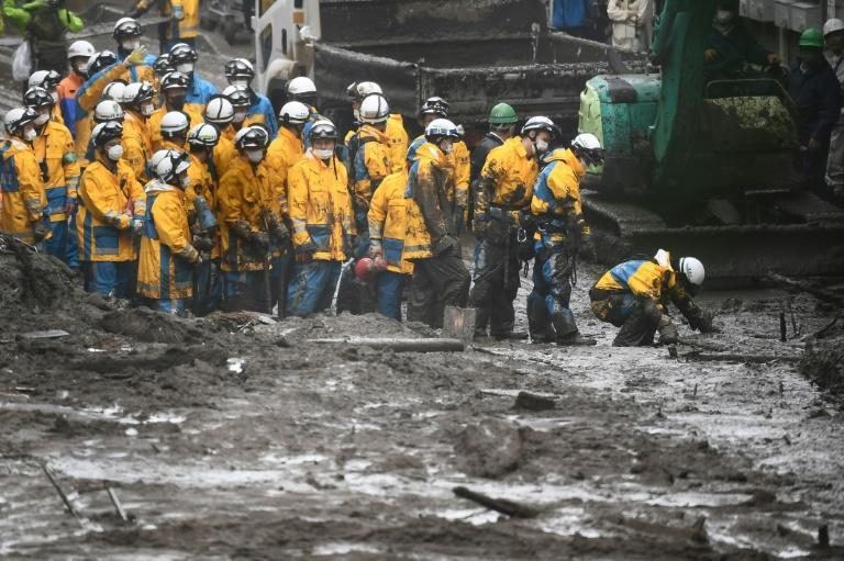 Hundreds of rescue workers and military personnel are combing through the mud and debris