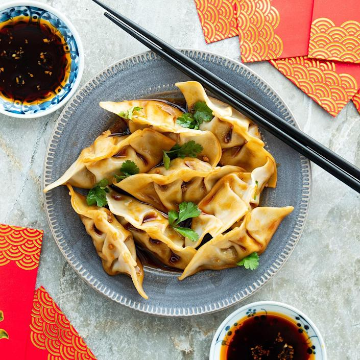 <p>Serve these deliciously savory mushroom-and-chicken dumplings for Lunar New Year or any other special occasion. The sauce has just the right balance of sweet, spicy and tangy flavors.</p>