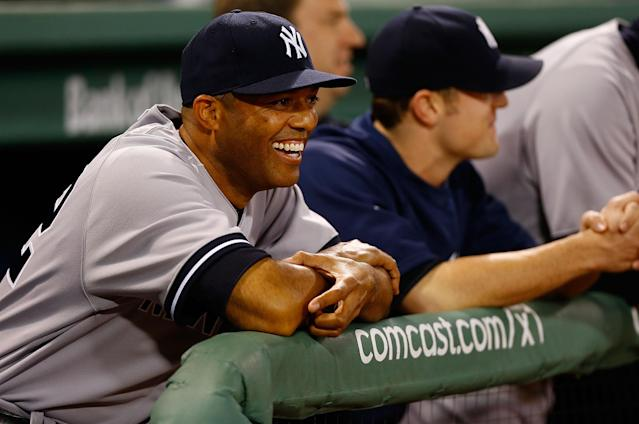 BOSTON, MA - SEPTEMBER 15: Mariano Rivera #42 of the New York Yankees laughs from the dugout during a video tribune that is shown in his honor prior to the game against the Boston Red Sox on September 15, 2013 at Fenway Park in Boston, Massachusetts. Tonight will be Rivera's final appearance at Fenway Park as he is set to retire at the end of this season. (Photo by Jared Wickerham/Getty Images)