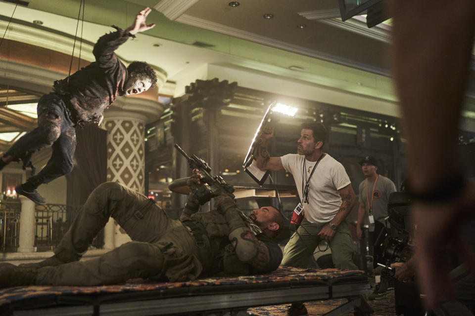 ARMY OF THE DEAD (L to R) DAVE BAUTISTA as SCOTT WARD, ZACK SNYDER (DIRECTOR, PRODUCER, WRITER) in ARMY OF THE DEAD. Cr. CLAY ENOS/NETFLIX © 2021