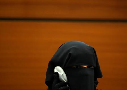 """South African Yumna Desai listens as she attends a side event called """"Silencing Dissident"""" during the Human Rights Council at the United Nations in Geneva"""