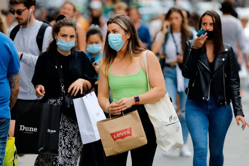 Shoppers wearing masks in London (AFP via Getty Images)