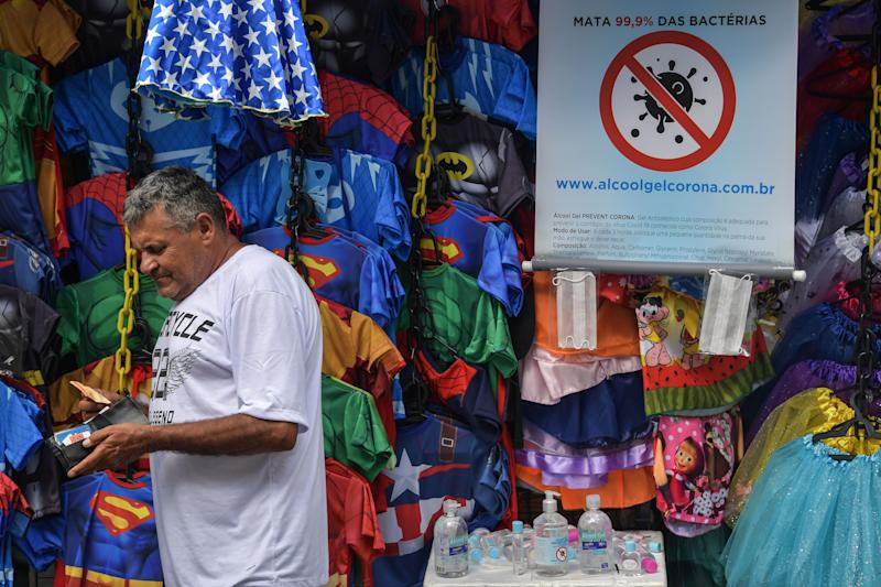 A street vendor sells hand sanitizer in downtown Sao Paulo, Brazil, on March 16, 2020. - The Sao Paulo stock exchange closed down 13.9 percent Monday and the Brazilian real closed below five to the dollar for the first time ever in further fallout from the coronavirus pandemic. (Photo by NELSON ALMEIDA / AFP) (Photo by NELSON ALMEIDA/AFP via Getty Images)