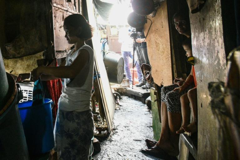 Homes in these slums are tightly-packed, tiny spaces that are only big enough for sleeping and lack running water