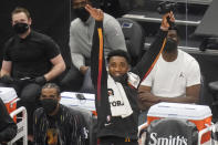 Utah Jazz guard Donovan Mitchell, right, celebrates after a teammate scored against the Orlando Magic in the second half during an NBA basketball game Saturday, April 3, 2021, in Salt Lake City. (AP Photo/Rick Bowmer)