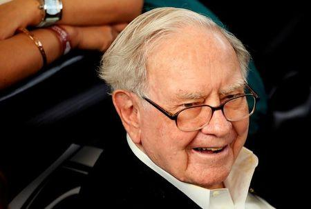 FILE PHOTO: Berkshire Hathaway CEO Warren Buffett waits to play table tennis during the Berkshire Hathaway annual meeting weekend in Omaha
