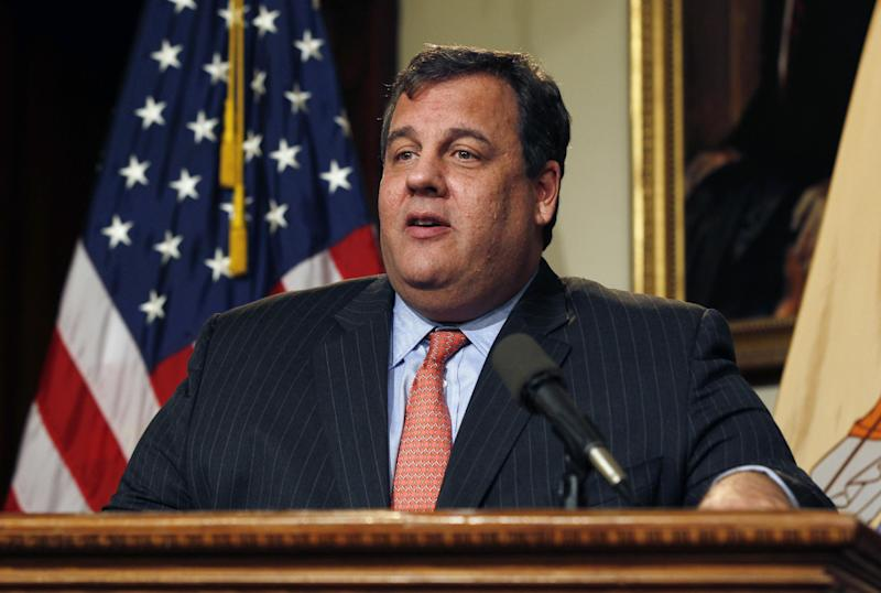 """In this Friday, Dec. 7, 2012 photograph, New Jersey Gov. Chris Christie reacts to a question during a news conference in Trenton, N.J. The Republican governor was asked about his weight problem during an interview with Barbara Walters for her """"10 Most Fascinating People"""" special Wednesday night on ABC. Walters told the governor some people say he is too heavy to be president one day. (AP Photo/Mel Evans)"""