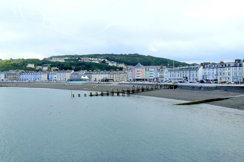 Aberystwyth, Wales, UK. July 22, 2016. The North beach and marine terrace taken from the Royal Pier at Aberystwyth in Wales.
