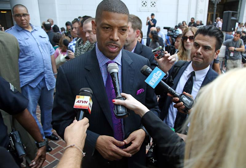 In this photo taken on April 29, 2014, Sacramento, Calif., Mayor Kevin Johnson speaks to reporters after his comments about the penalties imposed on Los Angeles Clippers owner Donald Sterling by the NBA at a news conference at Los Angeles City Hall. Last year Johnson almost single-handedly kept the Kings NBA franchise in Sacramento, staging a late-game comeback to snatch the team away from a Seattle billionaire. This spring he began raising his national political profile by taking over as the head of the U.S. Conference of Mayors, then acting as spokesman for the NBA players as the controversy over racist remarks by the Clippers' owner threatened to throw the basketball league into turmoil. (AP Photo/Nick Ut)