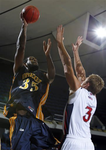 Drexel forward Dartaye Ruffin (35) shoots over Saint Mary's forward Mitchell Young (3) during the second half of an NCAA college basketball game in the first round of the DirecTV Classic in Anaheim, Calif., Thursday, Nov. 22, 2012. Saint Mary's won the game 76-64. (AP Photo/Alex Gallardo)