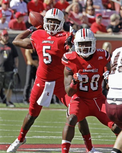 Louisville quarterback Teddy Bridgewater (5) looks to pass behind the protection from running back Jeremy Wright (28) during the first half of an NCAA college football game against Missouri State in Louisville, Ky., Saturday, Sept. 8, 2012. (AP Photo/Garry Jones)