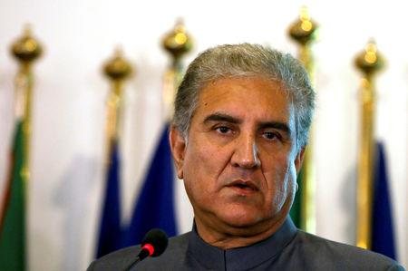 Pakistan's new Foreign Minister Shah Mehmood Qureshi listens during a news conference at the Foreign Ministry in Islamabad
