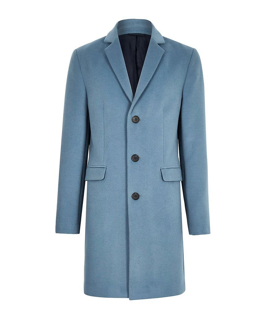 "<p>If you're looking to brighten up your usual all-black winter wardrobe, this coat will do the trick. <br>Shop it: River Island Olly Murs blue wool blend overcoat, $160, <a href=""https://fave.co/2qwlqbG"" rel=""nofollow noopener"" target=""_blank"" data-ylk=""slk:riverisland.com."" class=""link rapid-noclick-resp"">riverisland.com.</a> </p>"
