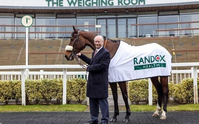 <span>Healthy interest: Dr Peter FitzGerald of Randox, the company that is sponsoring the Grand National, with horse Echo Springs</span>
