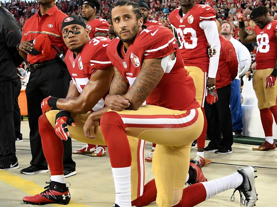 Colin Kaepernick (R) has receieved numerous honours for his efforts to highlight racial injustice in the United States: Thearon W. Henderson/Getty Images