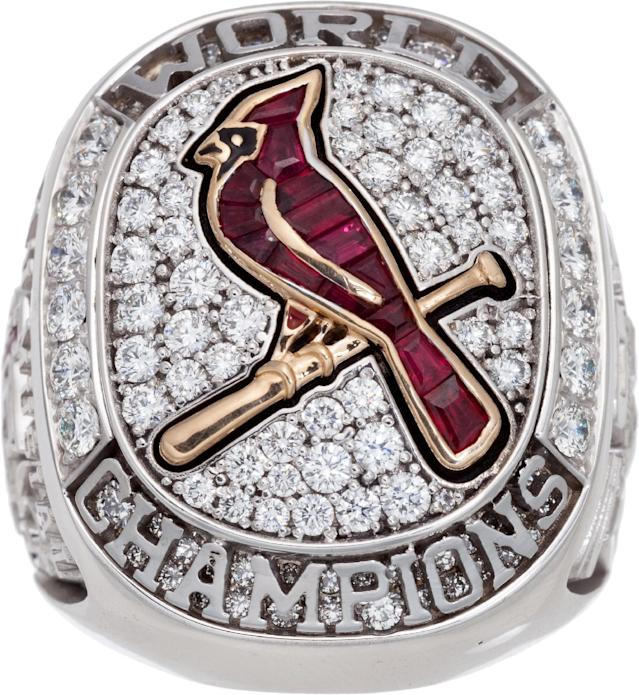 In this undated photo provided by Heritage Auctions is Stan Musial's 2011 St. Louis Cardinals World Championship ring that Heritage Auctions of Dallas said Monday, Nov. 11, 2013 sold for $191,200 at auction. Musial died in January at age 92. His family kept most of his belongings but grandson Brian Schwarze said Musial's four-bedroom Ladue home was stuffed with so many things he'd collected over the years that relatives decided on an auction. (AP Photo/Heritage Auctions)