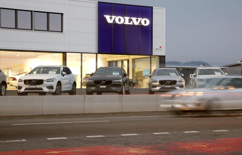 FILE PHOTO: A long exposure picture shows cars of Swedish automobile manufacturer Volvo displayed in front of a showroom of Stierli Automobile AG company in St. Erhard