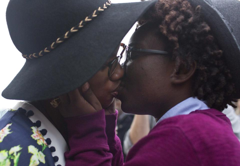 Tori Sisson, left, and Shante Wolfe kiss after saying their marriage vows, in Montgomery, Ala., Feb. 9, 2015. Sisson and Wolfe were the first same-sex couple to file their marriage license. The U.S. Supreme Court declared Friday, June 26, 2015, that same-sex couples have a right to marry anywhere in the country, in a culmination of two decades of litigation over marriage, and gay rights generally. (AP Photo/Brynn Anderson)
