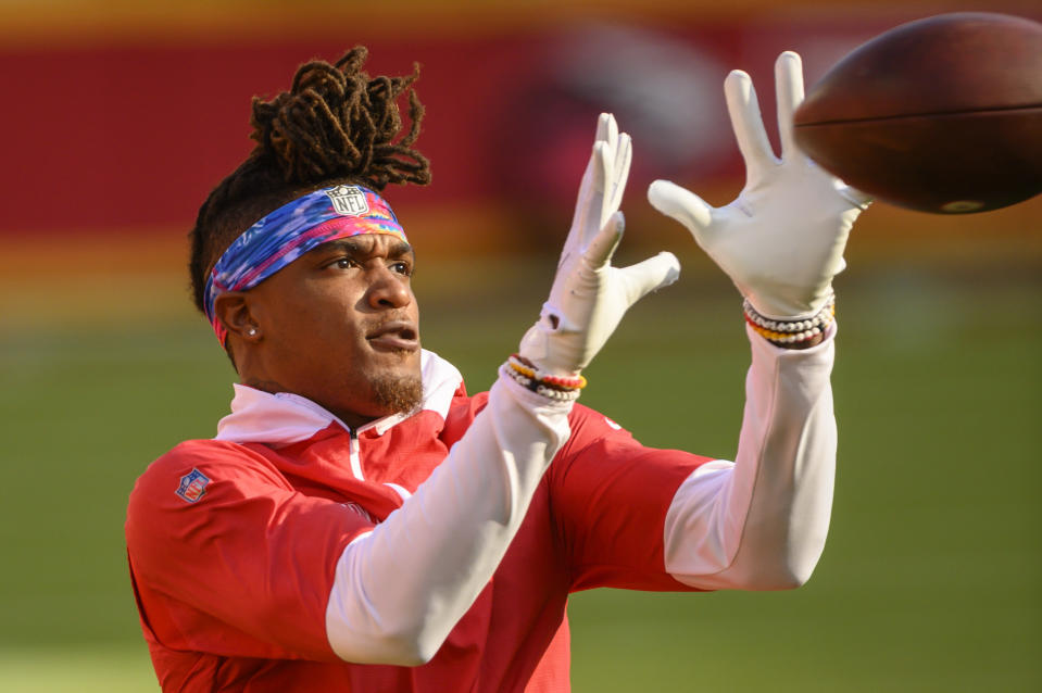 Kansas City Chiefs wide receiver Demarcus Robinson (11) wears a Crucial Catch headband during warmups before an NFL football game against the New England Patriots, Monday, Oct. 5, 2020, in Kansas City, Mo. (AP Photo/Reed Hoffmann)