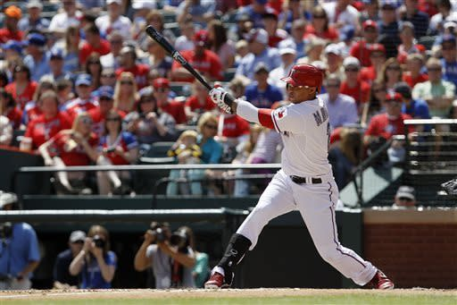 Texas Rangers center fielder Leonys Martin (2) hits a solo home run in the third inning of an MLB American League baseball game against the Seattle Mariners at Rangers Ballpark in Arlington, Sunday, April 21, 2013, in Arlington, Texas. (AP Photo/Brandon Wade)