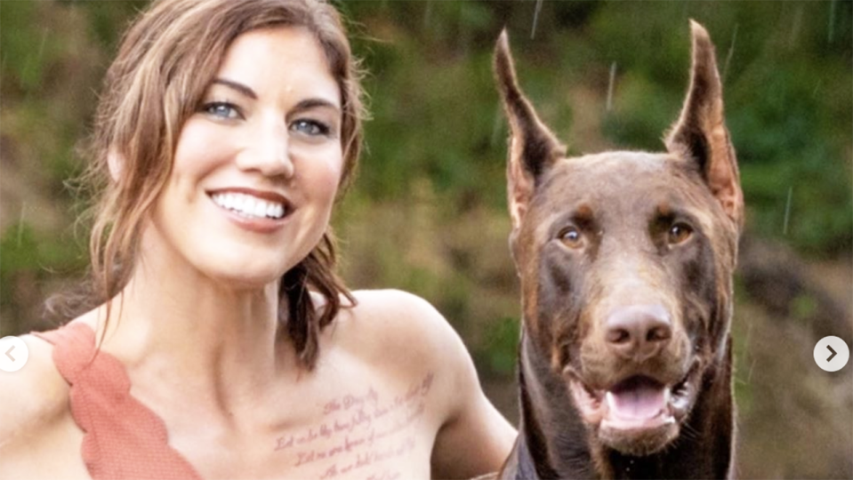 Hope Solo, pictured here wth her dog Conan before he was killed.