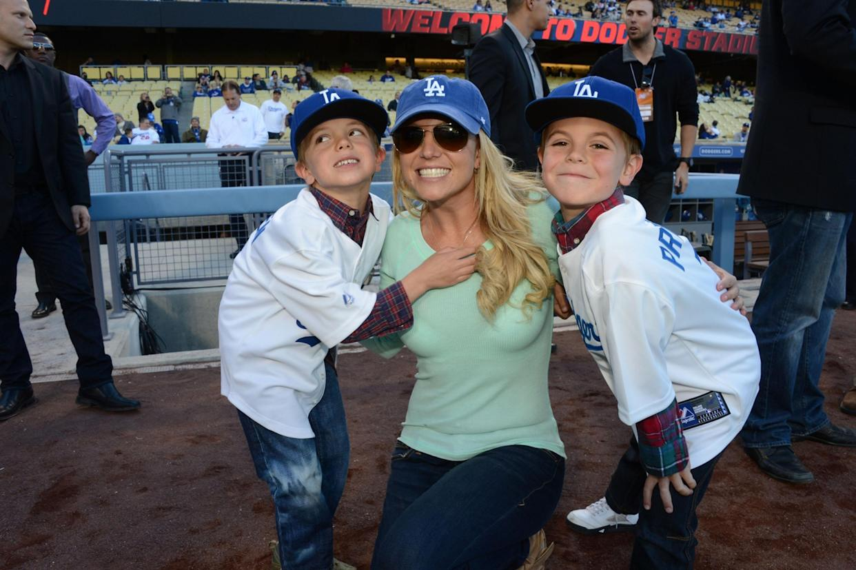 LOS ANGELES, CA - APRIL 17: In this handout photo provided by the LA Dodgers, Britney Spears poses with sons Jayden James Federline (L) and Sean Preston Federline (R) during a game against the San Diego Padres at Dodger Stadium on April 17, 2013 in Los Angeles, California. (Photo by Jon SooHoo/LA Dodgers via Getty Images)