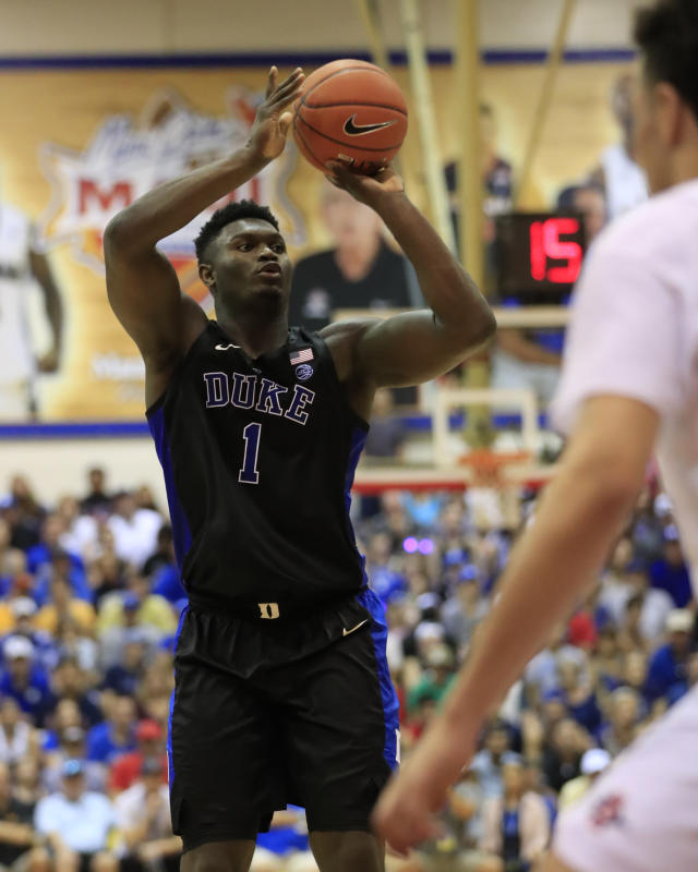 Duke forward Zion Williamson (1) goes for net over San Diego State during the first half of an NCAA college basketball game at the Maui Invitational, Monday, Nov. 19, 2018, in Lahaina, Hawaii. (AP Photo/Marco Garcia)