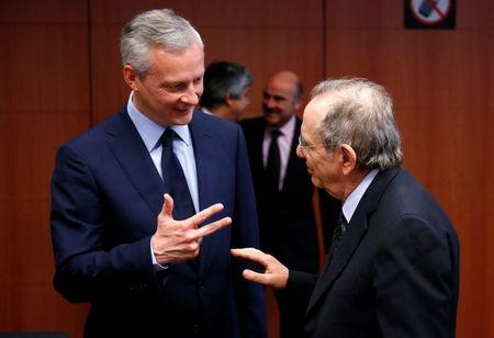 French Economy Minister Bruno Le Maire and Italy's Finance Minister Pier Carlo Padoan (R) attend a eurozone finance ministers meeting in Brussels, Belgium May 22, 2017. REUTERS/Francois Lenoir
