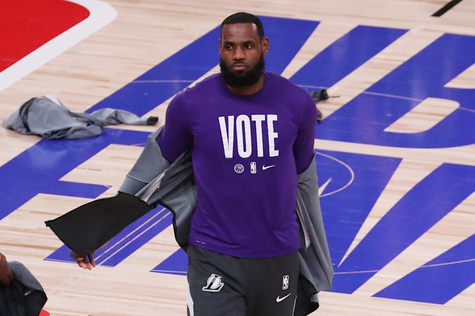 LAKE BUENA VISTA, FLORIDA - OCTOBER 09: LeBron James #23 of the Los Angeles Lakers wears a VOTE shirt during warm-up prior to the start of the game against the Miami Heat in Game Five of the 2020 NBA Finals at AdventHealth Arena at the ESPN Wide World Of Sports Complex on October 9, 2020 in Lake Buena Vista, Florida. NOTE TO USER: User expressly acknowledges and agrees that, by downloading and or using this photograph, User is consenting to the terms and conditions of the Getty Images License Agreement. (Photo by Sam Greenwood/Getty Images)