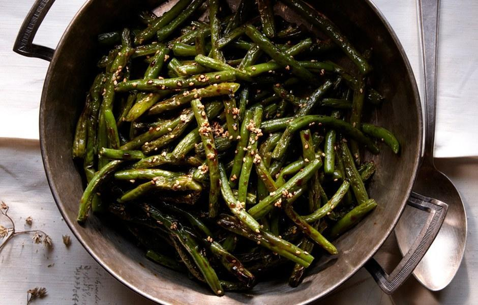 "Sorghum is a favorite ingredient of Blackberry Farm chef Joseph Lenn, who thinks of the grain when he thinks of fall flavors. <a href=""https://www.bonappetit.com/recipe/green-beans-with-benne-and-sorghum?mbid=synd_yahoo_rss"" rel=""nofollow noopener"" target=""_blank"" data-ylk=""slk:See recipe."" class=""link rapid-noclick-resp"">See recipe.</a>"