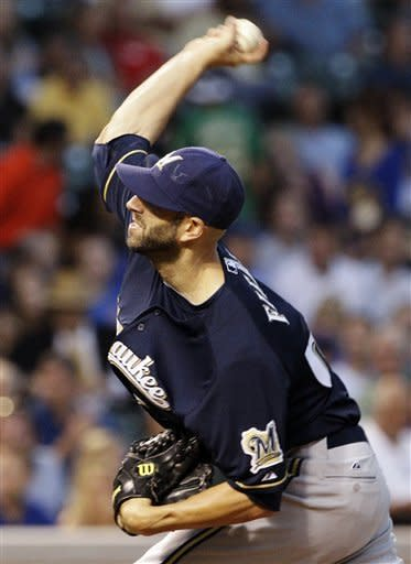 Milwaukee Brewers starter Mike Fiers throws against the Chicago Cubs during the first inning of a baseball game in Chicago, Wednesday, Aug. 29, 2012. (AP Photo/Nam Y. Huh)