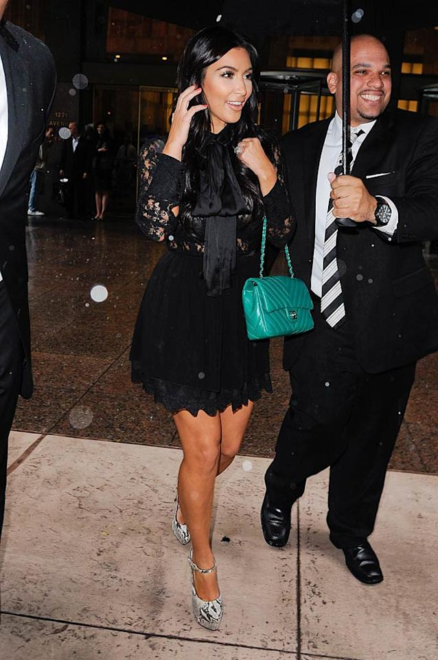 Newlywed Kim Kardashian donned a lace LBD in New York recently. Leave to the reality star to make one of the most popular wardrobe staples even trendier. (9/5/2011)